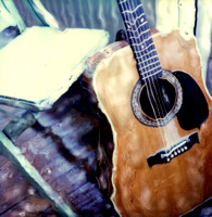 color photo of acoustic guitar