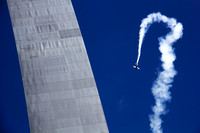 4th of july st louis photo of aerobatic WWI stunt biplanes and gateway arch